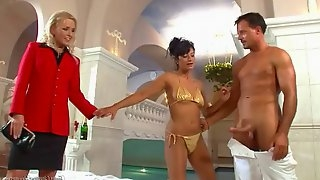 Pissing threesome gets wet by the pool