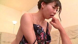 Naughty Japanese wife Miho Yui gives a foot rub down and sucks his dick