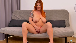 Aroused mature stands nude ready to finger fuck