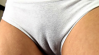 Horny girl Nike shows off her pretty cameltoe and boobs